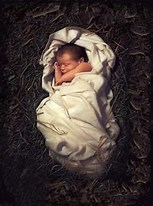 Infant sleeping in a manger